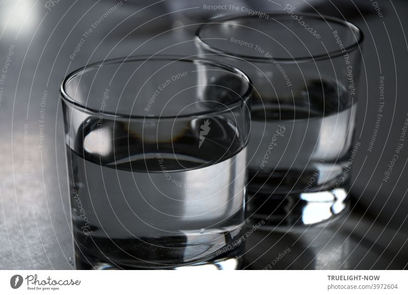 Two sober glasses filled with clear drinking water mirror and reflect almost colorless some daylight Water Drinking water Glasses Tumbler chill colourless Food