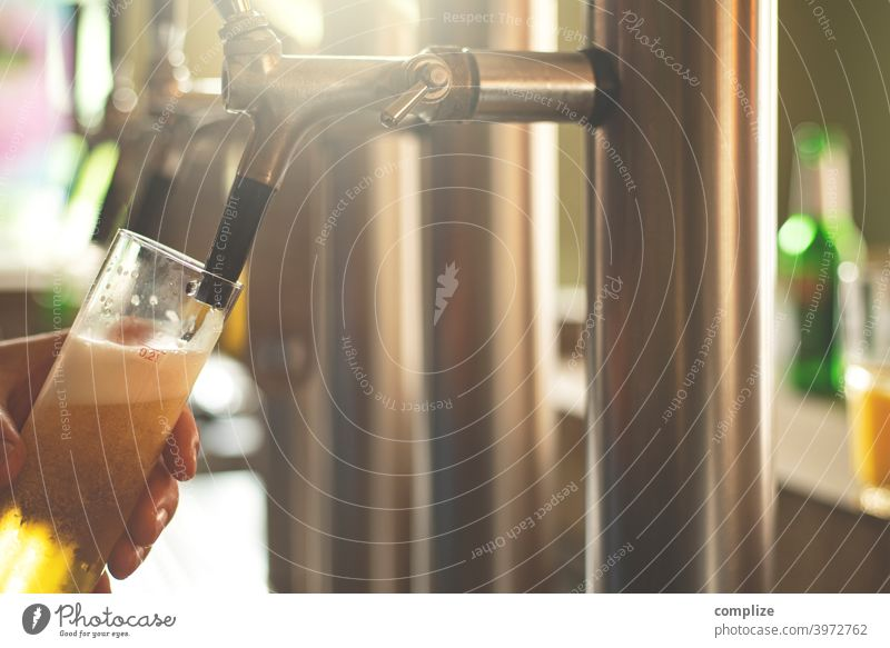 A fresh beer (Kölsch) is tapped at the tap in a bar Beer Alcoholic drinks Bar Roadhouse Spigot Gastronomy Restaurant Going out celebrations Drinking Beer glass