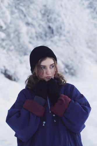Young woman with warm clothes, snow in the background. one person young adult Girl Youth (Young adults) Feminine portrait pretty Fresh naturally Authentic