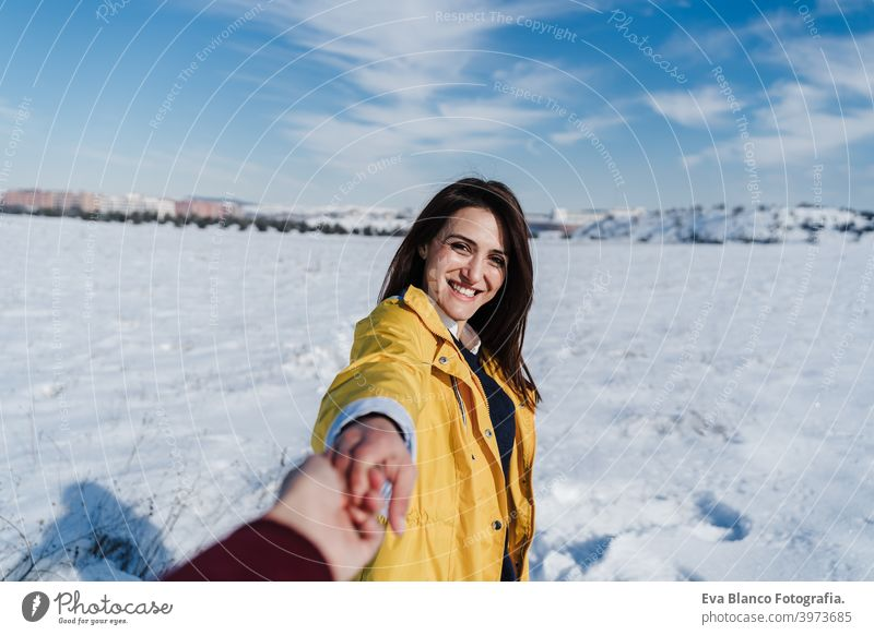 happy young woman holding hands with camera. snow mountain landscape. Follow me. Love and lifestyle in nature boyfriend love valentines snowy romantic scene