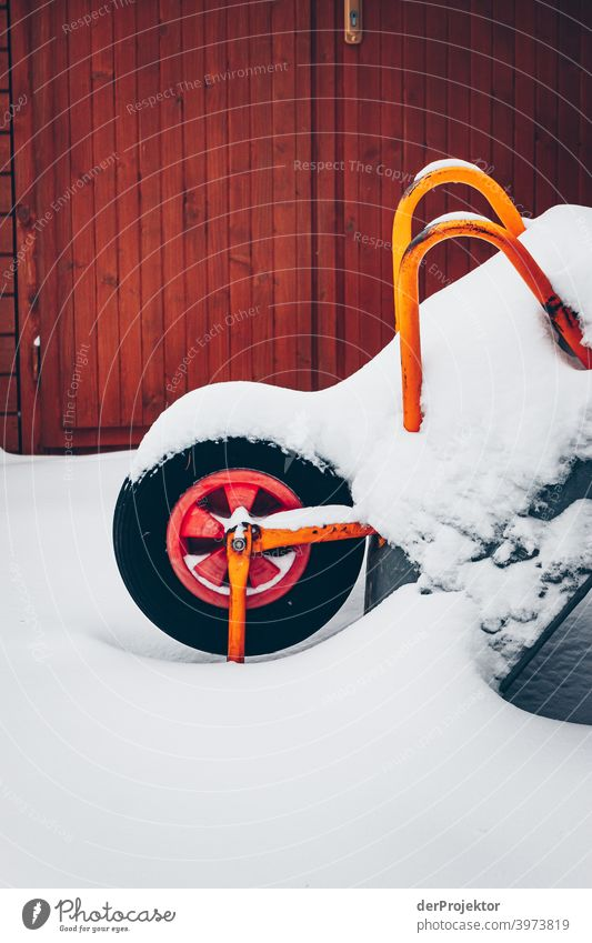 Wheelbarrow covered with snow Winter mood Winter vacation Esthetic Snow Exceptional Copy Space middle Sunlight Copy Space bottom Copy Space top Deserted