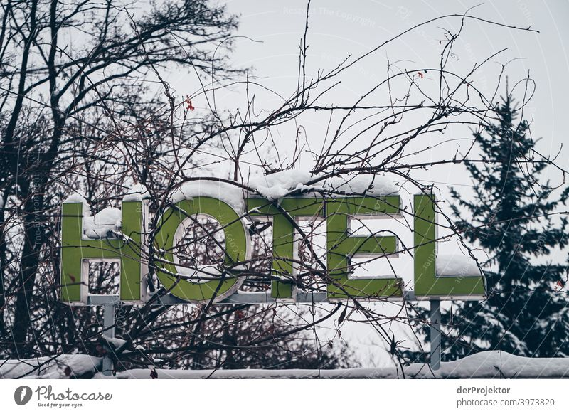 Hotel sign covered with snow Winter mood Winter vacation Esthetic Snow Exceptional Copy Space middle Sunlight Copy Space bottom Copy Space top Deserted