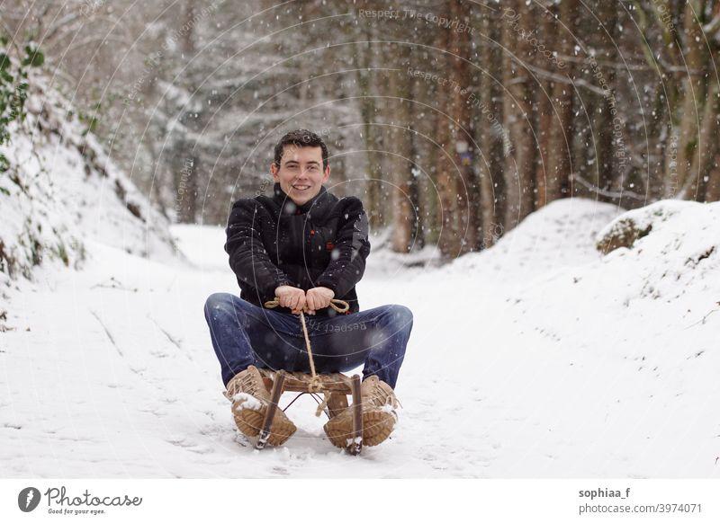 Man riding a sligh, having fun and laughing - Winter time & sledge fun sleigh man snow happiness adult childhood sledding winter happy joy sliding boy downhill