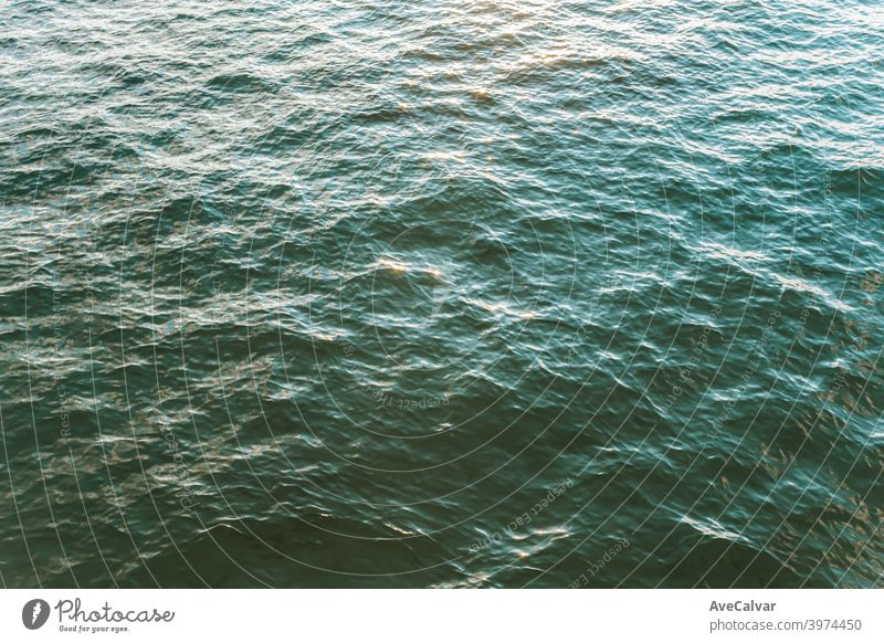 An aerial view of the colorful ocean during a bright day with relaxing vibes with copy space oceans copy-space meditation calmness textures peace awe excellent