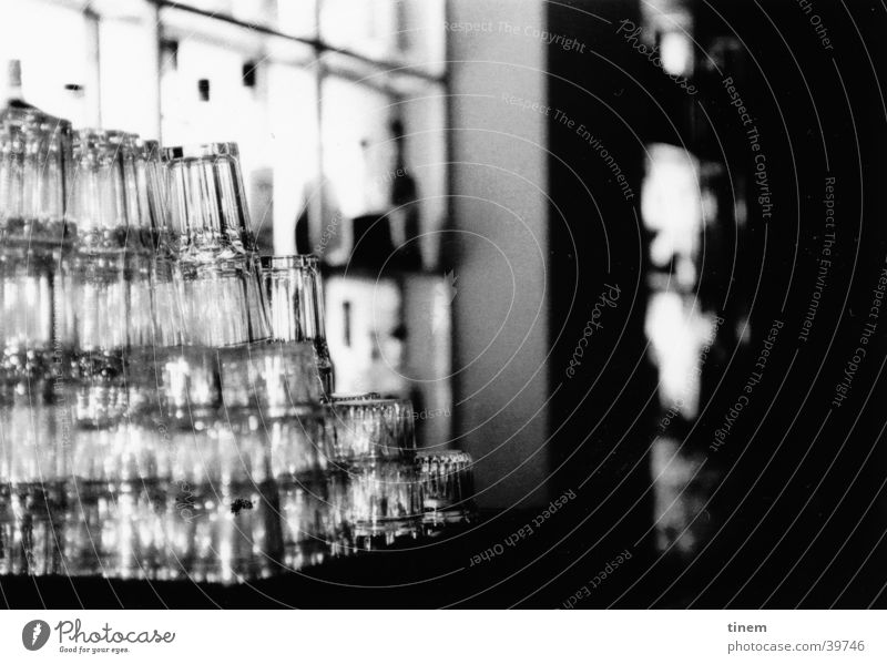 glass tower Bar Gastronomy Counter Glass Club Black & white photo Foyer Glas facade Stack