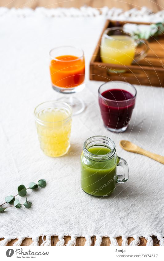Healthy juices in different glasses on a linen tablecloth Juice Fresh variation Glasses Fruit Beverage Nutrition Colour photo Healthy Eating Diet