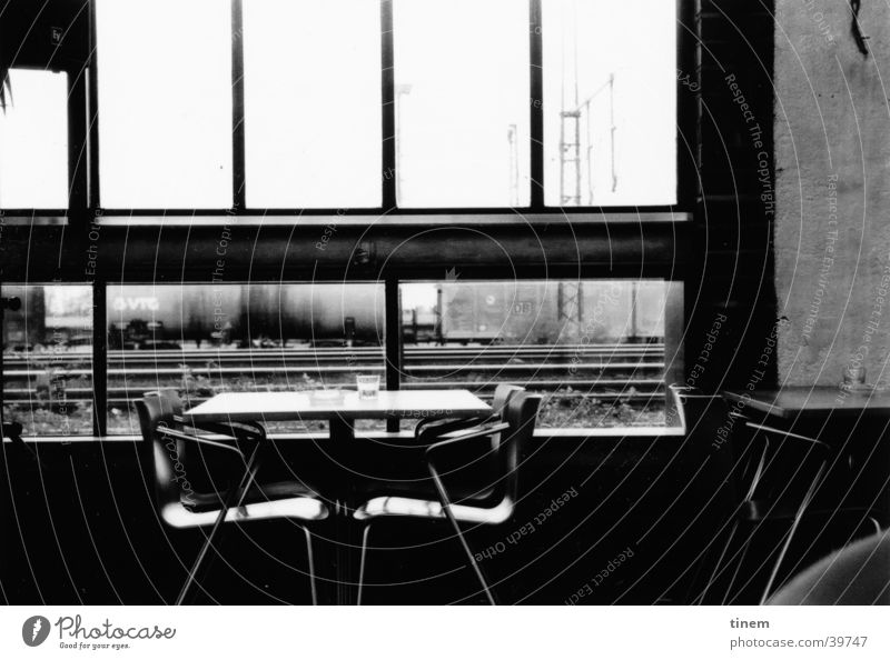 Vacation & Travel Window Table Vantage point Chair Bar Leisure and hobbies Gastronomy Railroad tracks Black & white photo Train station Foyer Accessible
