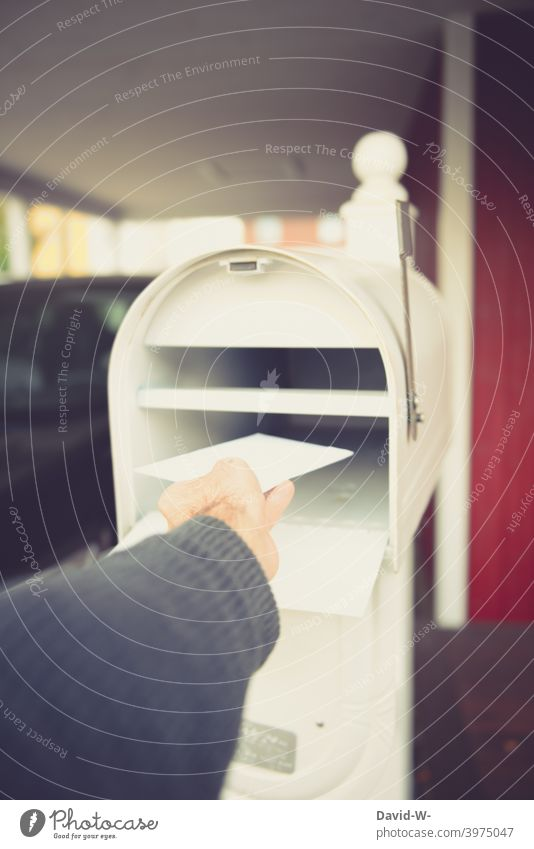 Retrieving a letter from the mailbox Communication Letter (Mail) Mailbox Envelope (Mail) message receiver Hand consignment Invoice get out