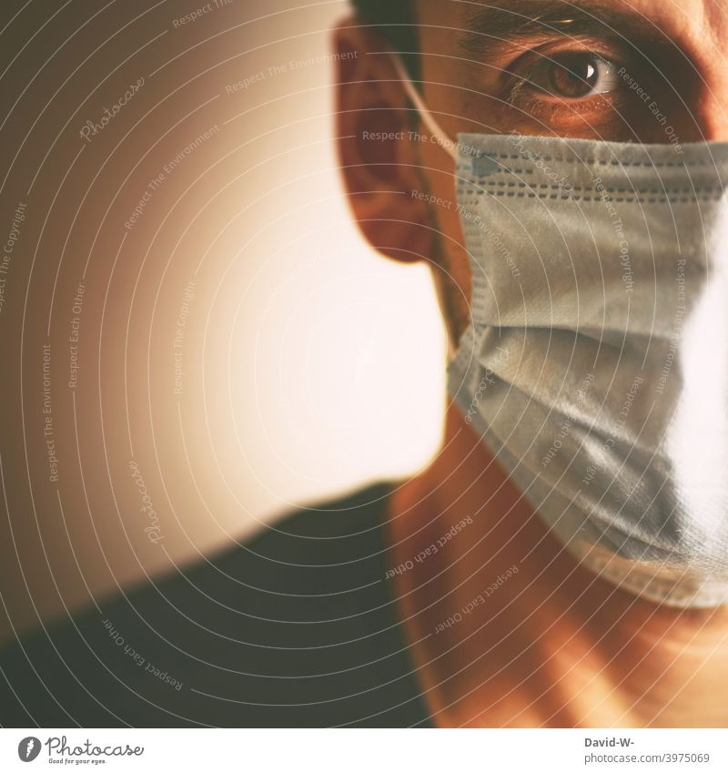 Corona - Man with medical mask / new rules coronavirus Medical Mask Tightening pandemic mutation Respirator mask Classification Protection