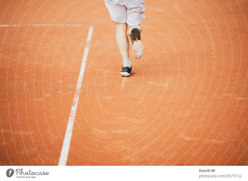 Athlete running on a sports field Sports Walking Running Sportiness Runner Running sports Speed Movement Jogger Healthy workout Fitness Man feet Legs