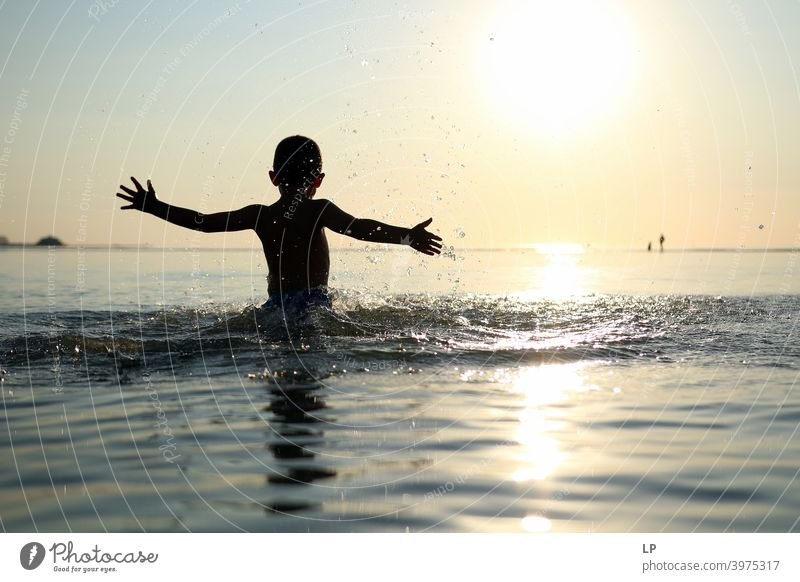 happy child in the ocean at sunset dancing Faith & Religion background Forward Arm Hand Contentment Dance Posture Vacation & Travel Twilight summer fun people