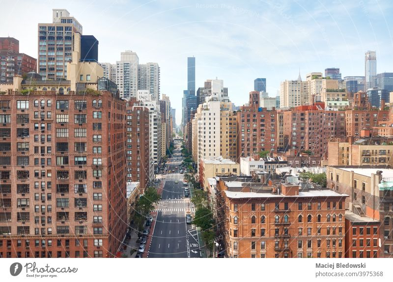 Manhattan cityscape on a sunny summer day, New York, USA. street car aerial skyline building apartment traffic road urban America NYC city life view new york