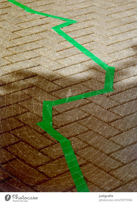 Zigzag in green on street pavement Line mark Marker line Green Street Lanes & trails off paving Paving stone paved Shadow Light Town Stone Border Pattern