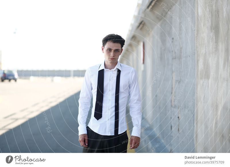 Young Handsome Male Model with Curly Hair and tie outside male Fashion Man teenager young Young man young adult Youth (Young adults) Curly hair brown hair