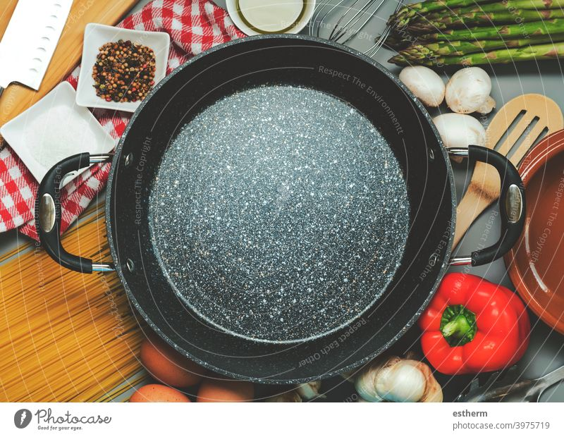 Top view of empty frying pan with ingredients for cooking meal nutrition chef tasty preparation mushroom kitchenware coating kitchen table culinary raw