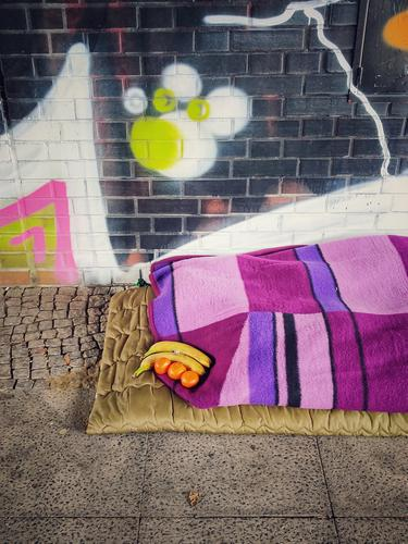 Homeless Help Under the bridge Blanket Graffiti Banana Tangerine neat variegated Berlin Colour photo Cold