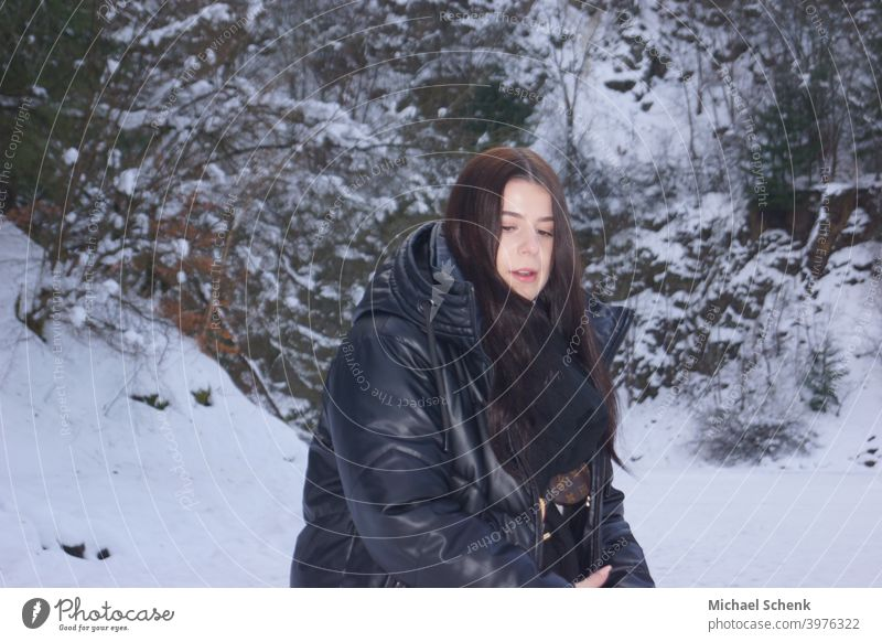 Young woman with long black hair in snow Woman 18 - 30 years Adults Nature Landscape Long-haired naturally Exterior shot Day portrait Snow Hair and hairstyles