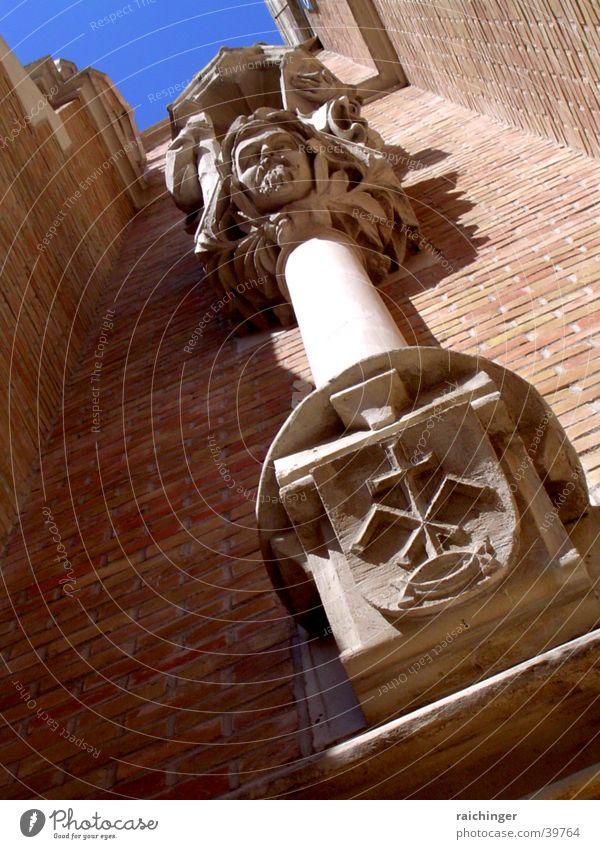Church facade, detail Facade Coat of arms Worm's-eye view Brick House of worship Religion and faith Column Upward Perspective Sky Blue