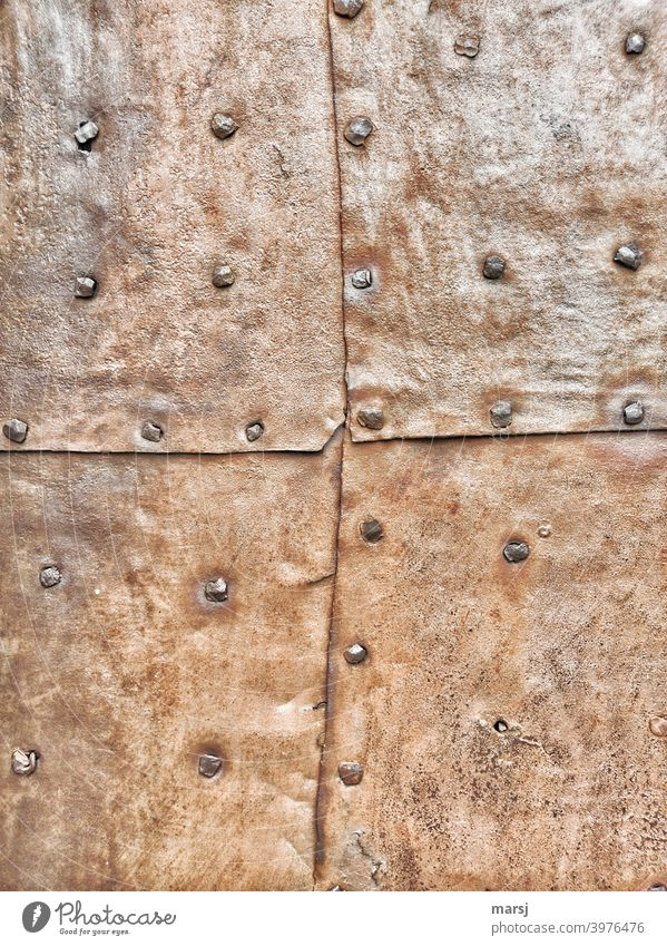 Contemporary history | 4 riveted, rusty metal panels that protect a door or facade from burglars and the weather Patchwork Craft (trade) mend Contrast Repaired