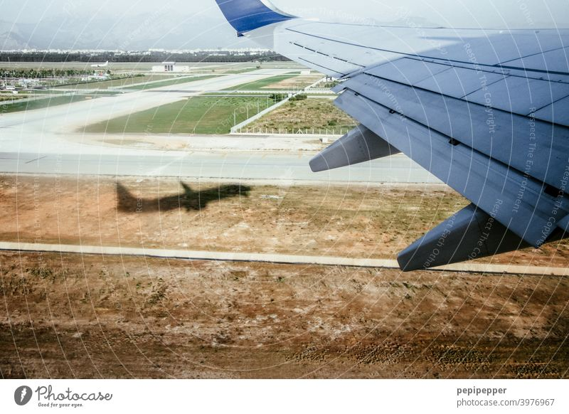 Off on holiday, shadow of a plane taking off Airplane View from the airplane Airplane takeoff take off Aviation Colour photo Exterior shot Passenger plane