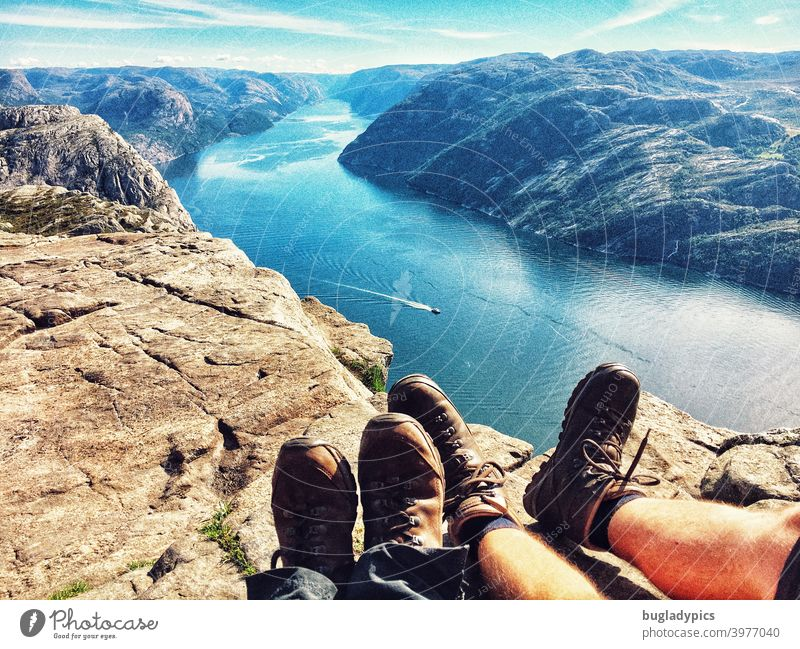 Rest your feet with a view over the Lysefjord Fjord fjord view Ocean Mountain Water Norway Scandinavia Vacation & Travel Sky Nature Landscape Rock Tourism