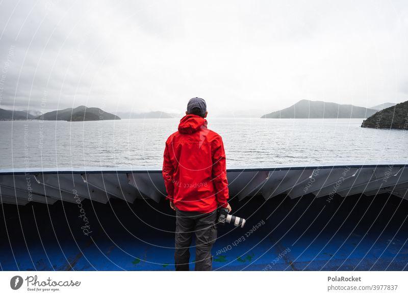 #AS# Land in sight Navigation Red camera Exterior shot Blue Ocean Sky coast Islands Railing Wide angle Hope Future North Island Ferry Crossing travel