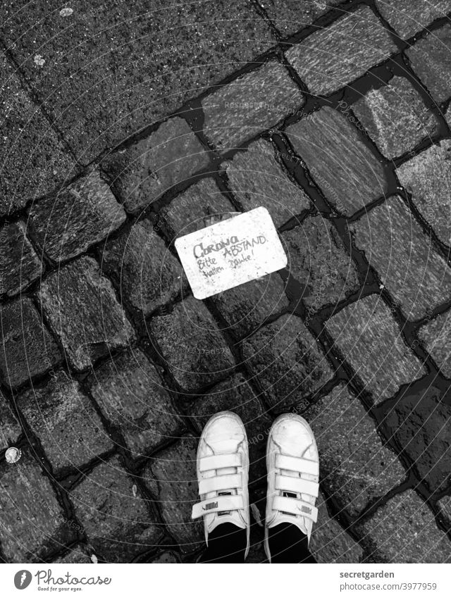 Please keep your distance. Thank you. feet sneakers Black & white photo Rich in contrast Contrast Paving stone Lanes & trails Signs and labeling Corona virus