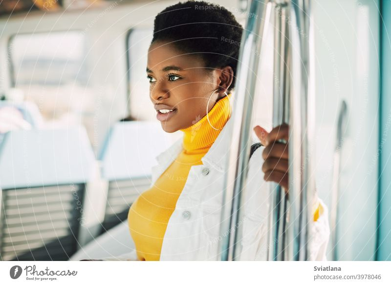 Portrait of a young African woman who rides the subway metro african standing train smiling inside portrait passenger urban black women black millennials