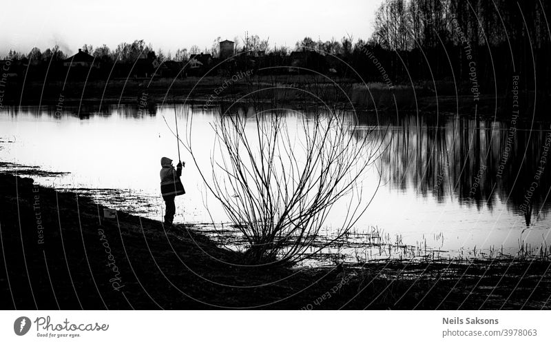 fish is not essential / relaxing by the river after spring floods Action activity angler blur calm dark dusk evening fisherman fishing freedom golden hobby