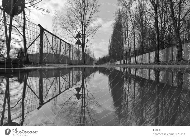 a big puddle in Mauerpark Berlin b/w wall park Prenzlauer Berg Puddle Black & white photo Town Deserted Exterior shot Capital city Downtown