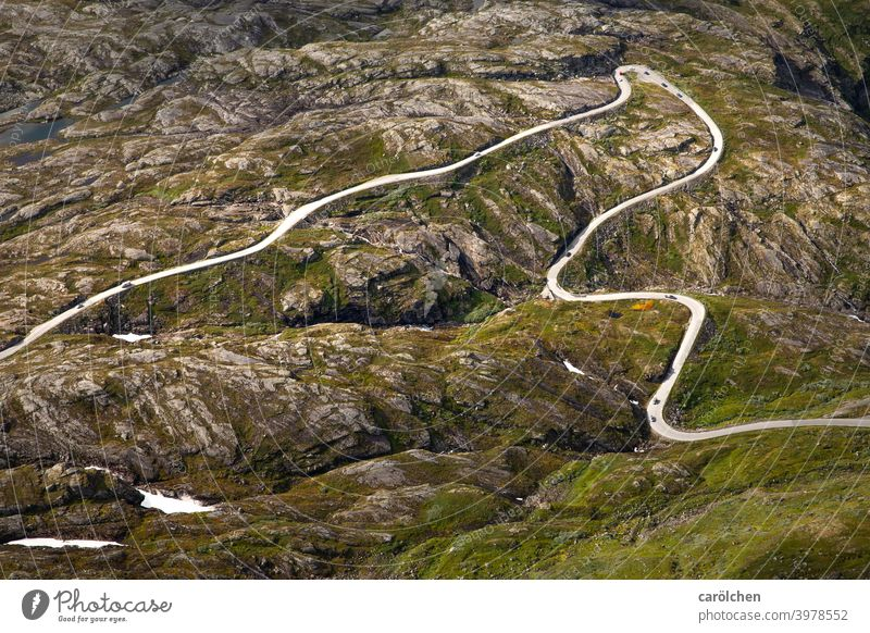 Road through rocky landscape in Norway Street Road traffic mountain road fjell Alpine Mountain Traffic infrastructure Transport curvaceous curves hairpin bend