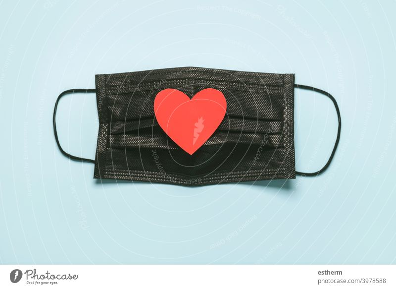 black Protective surgical mask with a red heart.Coronavirus epidemic concept coronavirus protective surgical mask coronavirus masks medical face masks