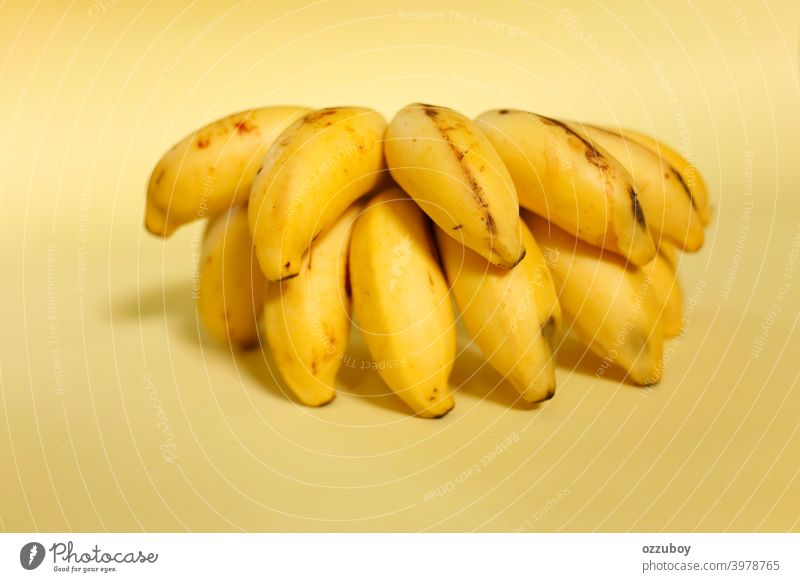 bunch of banana isolated on yellow background fruit snack food ripe healthy tropical closeup fresh diet organic freshness sweet group horizontal skin color