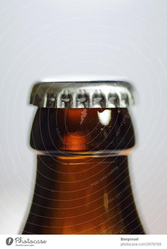 crown cork on a closed beer bottle Crown cap Crown cork Bottle Bottle of beer Closure Metal Glass Beverage Beer locked Brown Silver