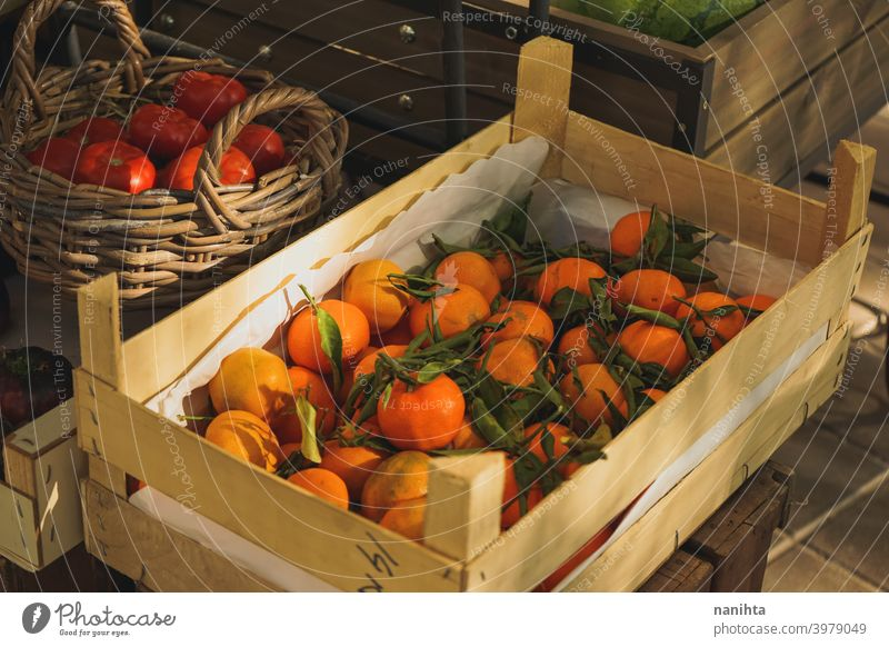 Self service fruit store with many organic products stall vegetables market delicious variety tomatoes clementines citrus fruits wood wooden basket harvest
