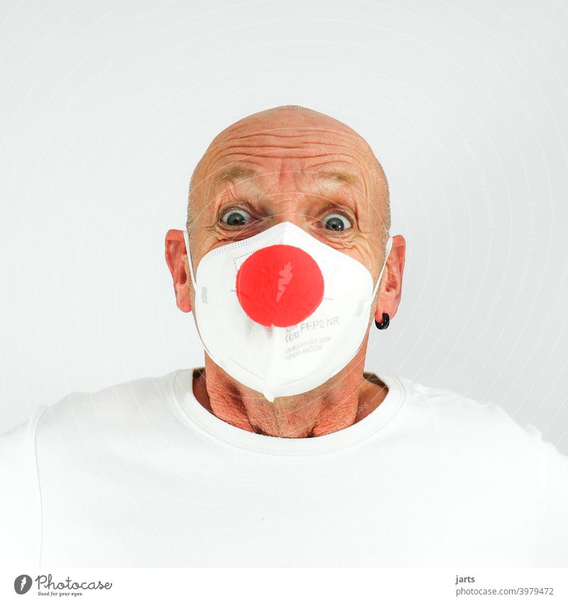 Funny man with FFP2 mask and red clown nose Mask ffp2 mask Mouth and nose mask Laughter Nose carnival Carnival eyes crease Protection covid-19 pandemic Optimism