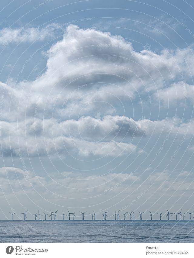 Clouds sea and wind turbines wind farm Pinwheel Wind energy plant eco-power Renewable energy Ocean Electricity Alternative Energy Environmental protection Rotor