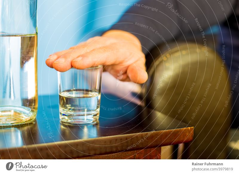 A man put his hand on a glass, he doesn't want to drink. Close-up Glass Beverage Hand Alcoholic drinks booze Drinking Bar Table Party Night life Club Lifestyle