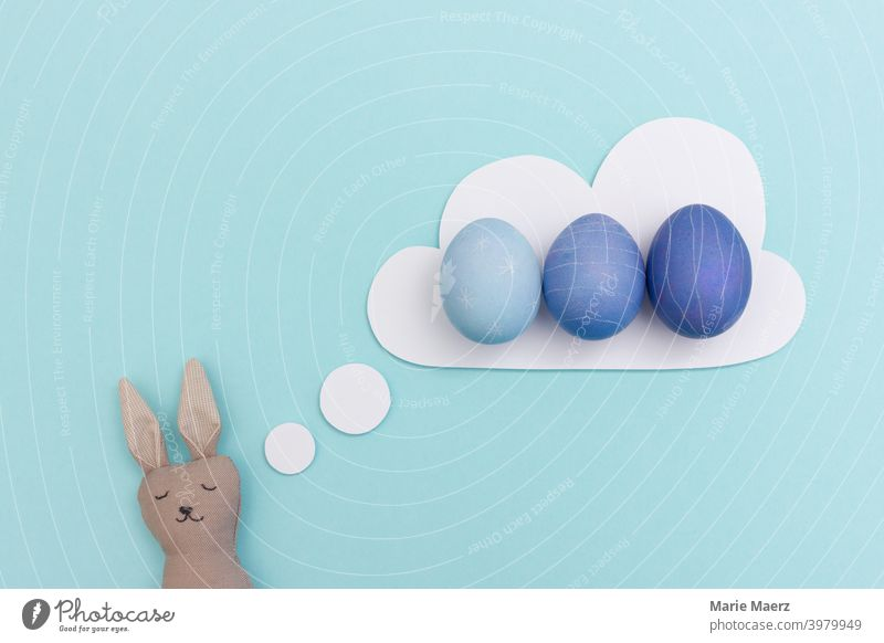 Easter bunny dreams of blue dyed easter eggs rabbit Design Dream daydreaming Easter Bunny Easter egg Easter eggs Egg fun Funny Happy Public Holiday Humor