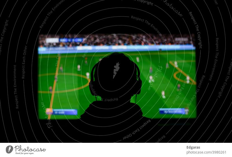 Playing videogames or watching football Console Videogames Games Watching football Football Dark Tv Television Sports Sporting event Football stadium