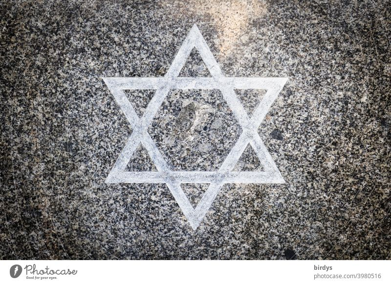 Star of David on a granite stone slab. Judaism , hexagram symbol with religious meaning.central perspective Religion and faith Jewish faith Granite Granite slab