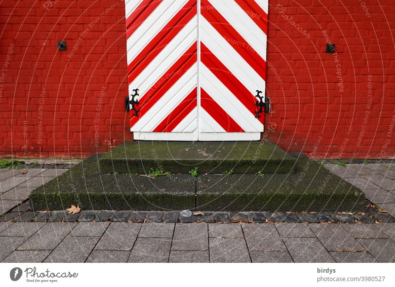 Antique entrance door in red and white with steps in front. Medieval door, red brick wall Old medieval Reddish white Striped Diagonal stagger Entrance