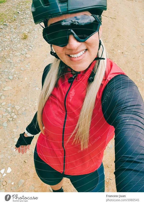 Beautiful cyclist woman selfie training in the mountain. smile cycling young portrait people hat child kid person happy teen fashion beauty smiling white cap