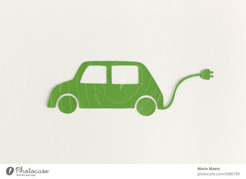 E-car | paper illustration of green car with power cable e-car Symbols and metaphors Mobility Future Means of transport Vehicle Electricity Technology