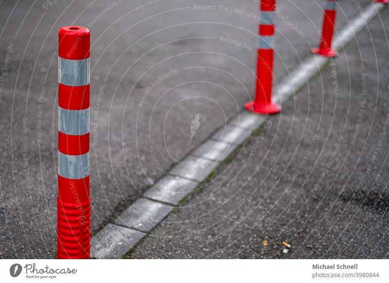Red and white bollards cordon Bollard Barrier Safety Protection Structures and shapes Bans forbidden