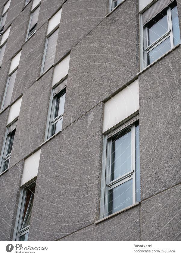 Detailed view of a modern prefabricated housing estate block of flats Gray Concrete Concrete slab Prefab construction Modern Old Gloomy bleak Cold Inhumane
