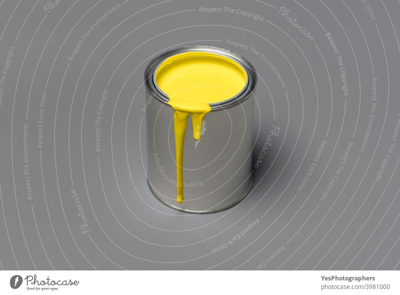 Yellow paint can on gray background. Tin can with  yellow paint, 2021 trend color 13-0647 17-5104 acrylic blank chalky paint color scheme colors container