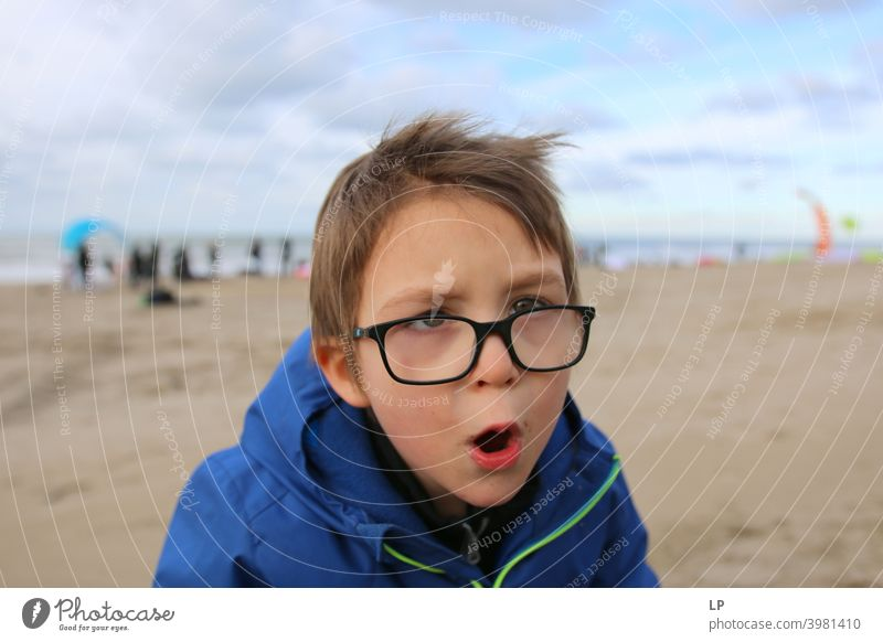 child shouting at the camera Looking into the camera Portrait photograph Upper body Sunlight Light Structures and shapes Exterior shot Multicoloured Aggression