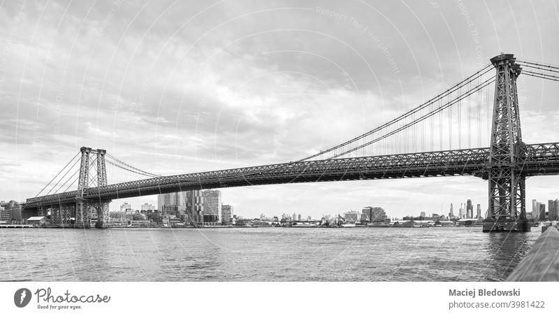 Black and white picture of Williamsburg Bridge, New York City, US. city black and white bridge river America NYC B&W architecture cityscape USA travel urban