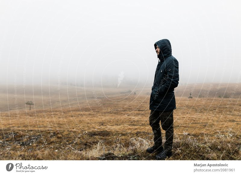 Young man exploring nature on a wet winter morning in the mountains adventure alone autumn beautiful challenge cold europe exploration explore explorer fog